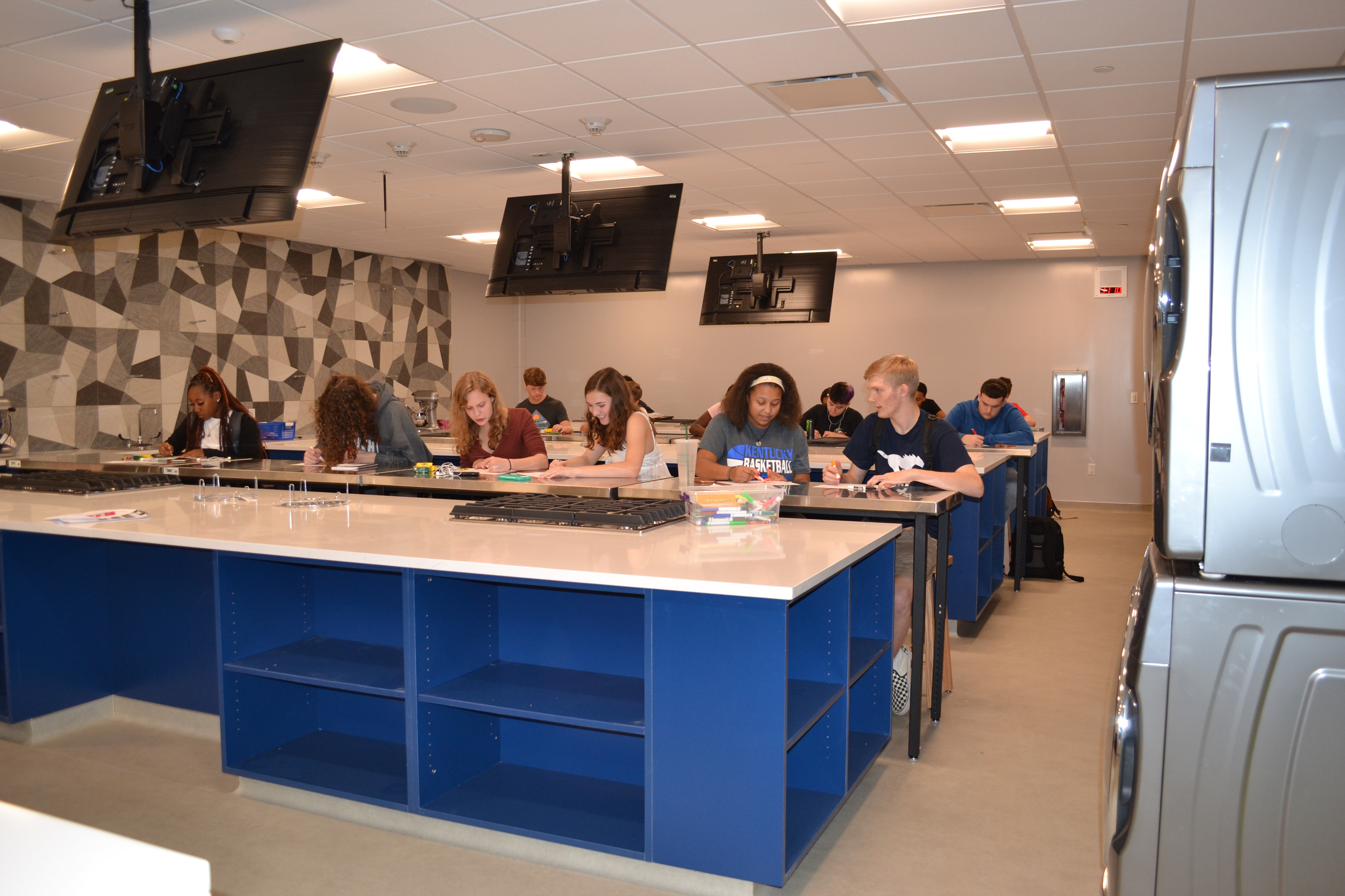 The new culinary lab at Downers Grove South. Each lab contains six large work stations that look like kitchen islands that faces a teacher demonstration station at the head of the class.