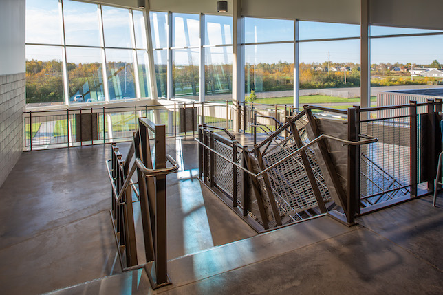 The 333,606-square-foot high school includes the addition of railing infill panels made by Banker Wire, a manufacturer of woven and welded wire mesh for architectural and industrial applications.