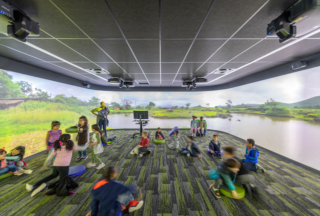 The Immersion Studio includes interactive projectors and screens for creative projects.