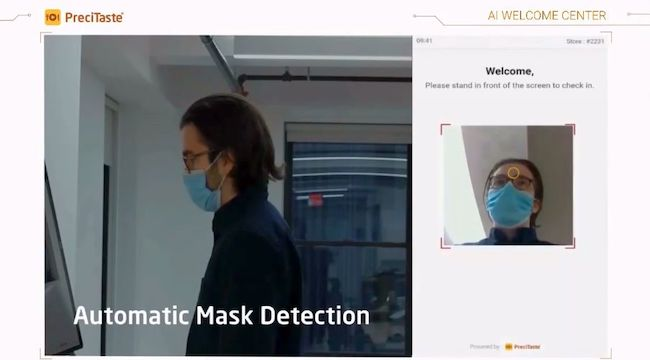 "AI Welcome Center automatically turns on when a person faces it. Then it performs a quick temperature measure with laser-sensing technology and checks for face masks using ""vision AI."""