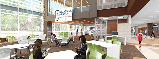 "A ""think tank"" area overlooking the library provides a glass-walled space where students are encouraged to collaborate, while still allowing teachers to oversee activities."