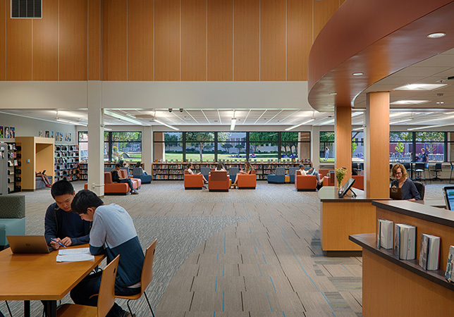 By moving the library to a corner of the building, it now has ample daylight coming from windows which has dramatically changed the space.