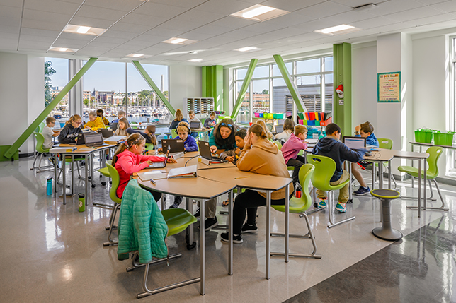 Transformed from an office building, the school includes 18 light-filled classrooms; collaborative learning spaces; media, arts and tech/robotics spaces on the first floor; and multi-purpose spaces for community meetings.