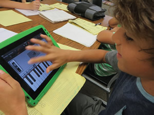 Student learning on a tablet
