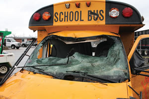 school bus damaged from natural disaster
