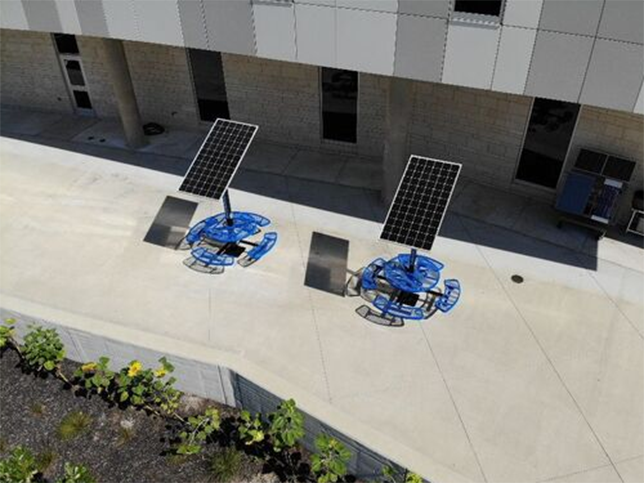 Over the summer, Olathe West High School added solar panels over two picnic tables where students can charge their phones and laptops.