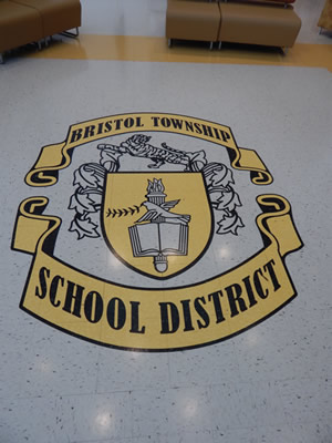 school logo/crest on hallway floor